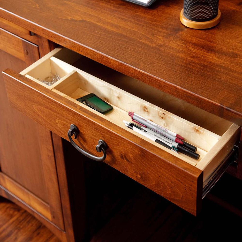 Writing desk with keyboard tray pullouts